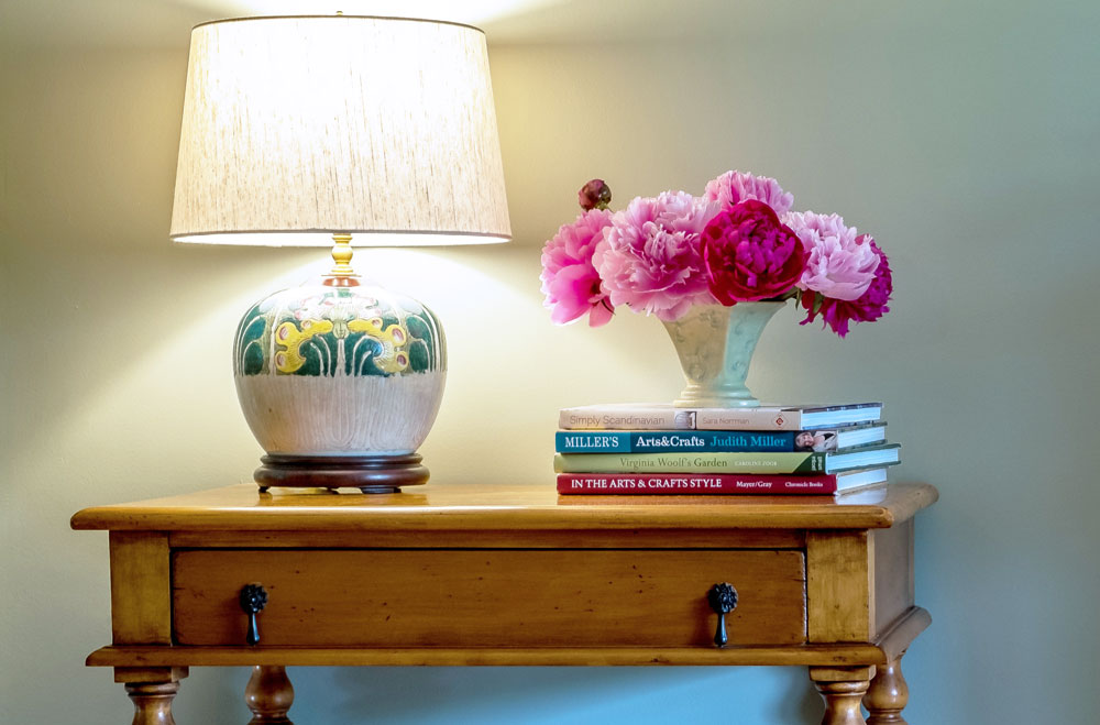 Antique table with chinese vase lamp and flowers