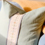 Blue loveseat with decorative pillow by Amy Brooke Interiors